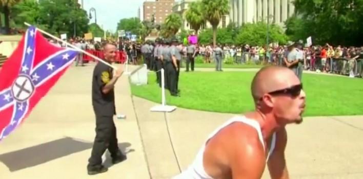 Confederate Flag Supporter Mimics Gorilla To Black Protesters
